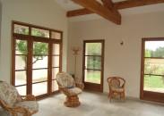 Ensemble de portes-fenêtre bois en rénovation style contemporain