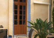 Porte fenêtre bois à petits carreaux